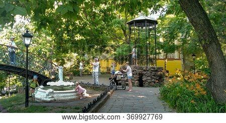 Odessa, Ukraine - June 18, 2019: Unidentified People Rest In The Thematic Corner Of Old Odessa Squar