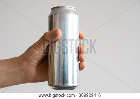 Aluminum Can With Carbonated Drink In A Male Hand