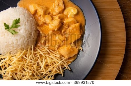 Chicken Strogonoff With Rice And French Fries (potato Sticks) On Dish.
