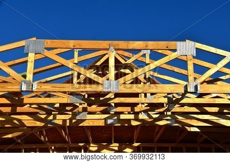 Pre-built Trusses And Rafters Are In Place On A New Constructed Garage.