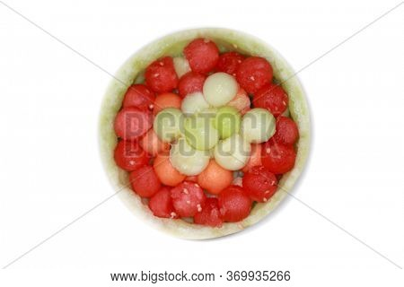 Balls of water melon, honey dew, and Cantaloupe in water melon shell isolated on white background
