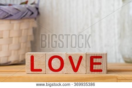 Written On Wooden Blocks Love And Red Heart.