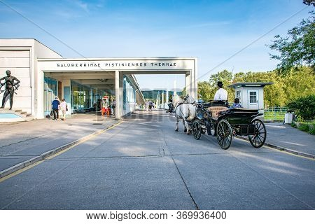Piestany, Slovakia - May 16 2017:  Horse Drawn Carriage With Driver And Passengers In Front Of Bridg
