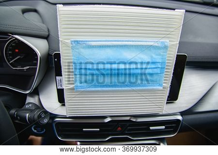 Car Air Conditioner Air Filter And A Protective Mask Against Bacteria On It