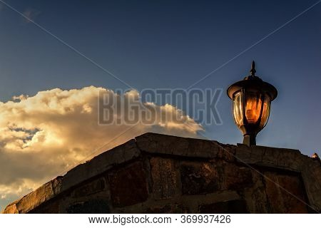 A Vintage Lamp On An Old Wall In Rwanda
