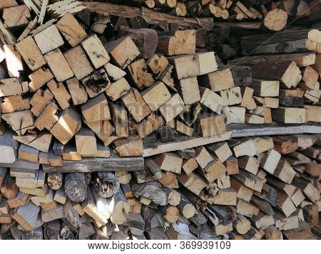 Firewood In Uneven Rows Stacked In A Woodpile