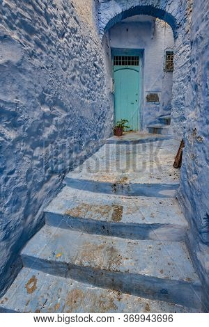 Blue Door On Blue Wall In Chefchaouen, The Blue City Of Morocco. It's Known For The Striking, Blue-w