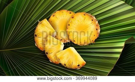 A Set Of Slices Of Chopped Pineapple On A Leaf.