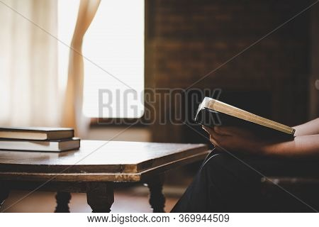 Woman Praying On Holy Bible In The Morning.