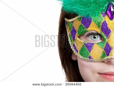 Young Girl In A Mardi Gras Mask With Copy Space