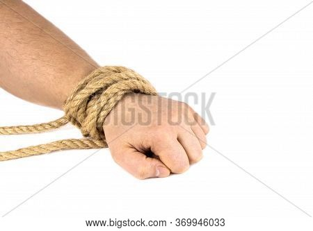 A Mans Hand Is Tied With A Rope Isolated On A White Background. Bound Hand. Modern Slavery