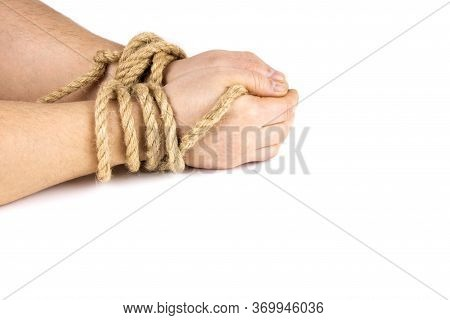 Mans Hands Are Tied With A Rope Isolated On A White Background. Bound Hands. Modern Slavery
