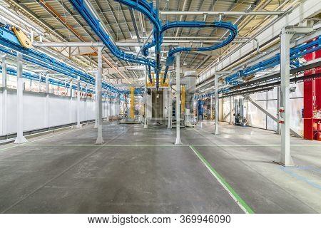 Powder Coating Line. Industrial Interior. Workshop Equipped With Conveyors.