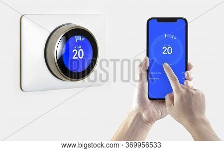 A Person Using A Smart Phone Application Cooling Down The Room Temperature With A Wireless Smart The