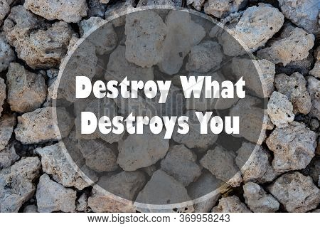 Inspirational Motivational Quote - Destroy What Destroys You Written On A Stone Wall.