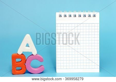 Abc-the First Letters Of The English Alphabet On A Blue Background. Empty Space For Text. Blank Note
