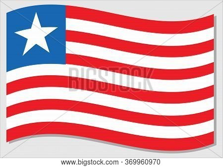 Waving Flag Of Liberia Vector Graphic. Waving Liberian Flag Illustration. Liberia Country Flag Wavin