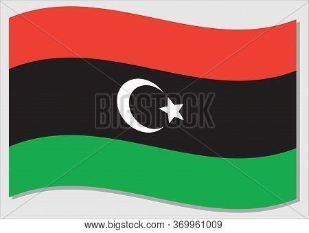 Waving Flag Of Libya Vector Graphic. Waving Libyan Flag Illustration. Libya Country Flag Wavin In Th