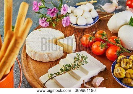 Mozzarella Baby Brie Cheese, Bulgarian Cheese And Mozzarella Fresca With Garlic And Grapes And A Gla