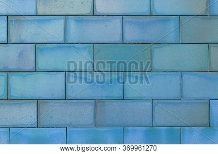 Brick Tiled Blue Old Wall Made Of Symmetrical Blocks. Abstract Colorful Background