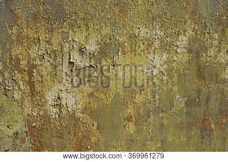 Rusty Damaged Cement Wall With Peeling Paint And Stains. Abstract Dramatic Colorful Vibrant Backgrou