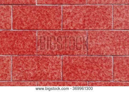 Red Brick Wall Made Of Symmetrical Stone Blocks With Stains. Natural Pattern. Abstract Colorful Back