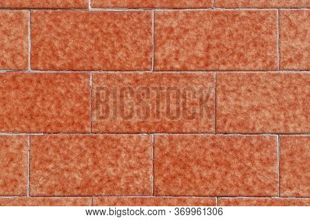 Brown Brick Stone Wall Made Of Symmetrical Blocks With Spots. Natural Pattern. Abstract Colorful Bac