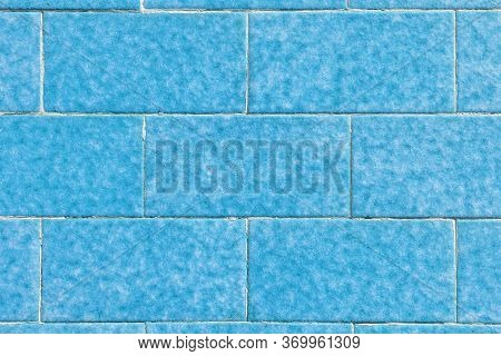 Blue Brick Stone Wall Made Of Symmetrical Blocks With Natural Pattern. Abstract Colorful Background