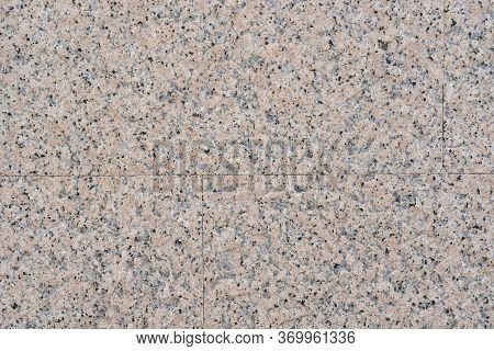 Closeup Of Granite Tile On The Wall. Stone Beige Spotted Abstract Background. Material For Design An