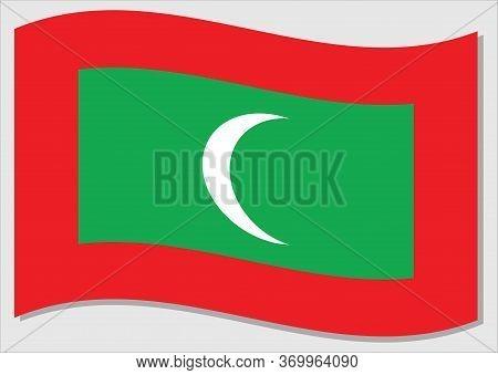 Waving Flag Of Maldives Vector Graphic. Waving Maldivian Flag Illustration. Maldives Country Flag Wa