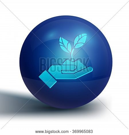 Blue Plant In Hand Of Environmental Protection Icon Isolated On White Background. Seed And Seedling.