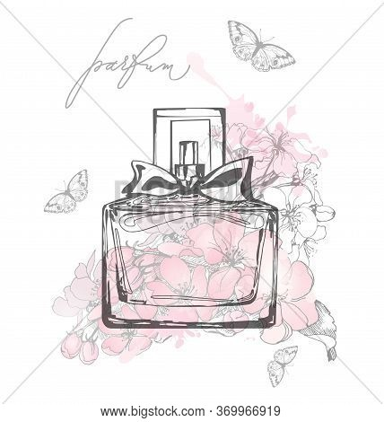 A Beautiful Bottles Of Perfume A Against The Background Of Delicate Apple Blossoms Womens Perfume. E