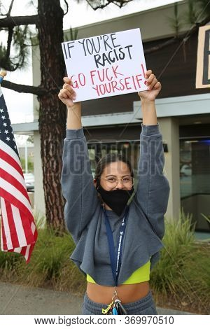 Lake Forest, CA/ USA - June 6, 2020: Protesters hold signs, chant slogans, and peacefully protest the Death of George Floyd and their support for Black Lives Matter wearing Covid19 Masks. Editorial.