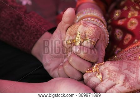 Indian Bride And Groom Holding Hands At Wedding Day