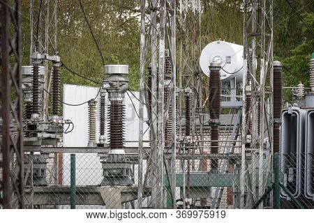 High-voltage Wires And Insulators In A Modern Substation. Isolation And Circuit Breaker In A Power P