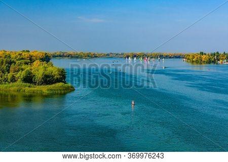 Many Yachts At River Dnieper On Autumn In Kremenchug, Ukraine. Sailing Regatta