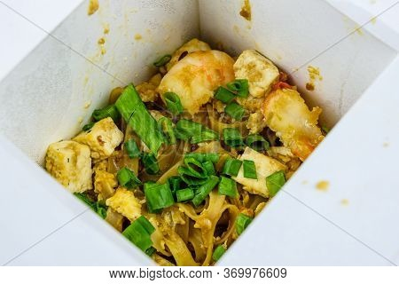 Pad Thai With Tofu And Green Onion In Paper Box