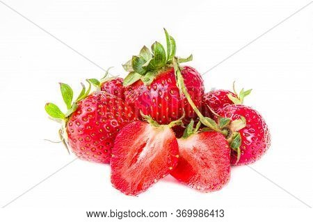 Raw Whole And Half Sliced Strawberry. Fresh Summer Strawberries Fruits Isolated On White Background