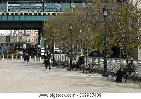 Bronx, New York/usa - April 25, 2020: People Outdoors Near Yankee Stadium During Coronavirus Pandemi