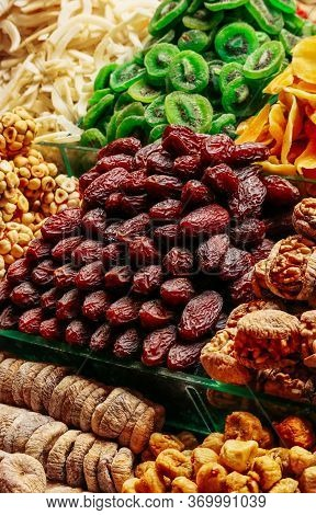 Dried Fruit In A Pile On The Asian Market Showcase. Dates, Kiwi, Figs, Nuts, Mango, Banana. Turkish