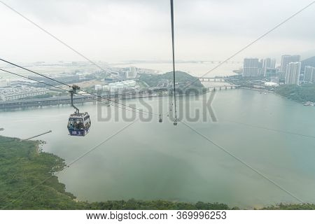 Hong Kong, May 2018 - View Of The Ngong Ping 360 Cable Cars Goingover The Bay, Lantau Island, Hong K