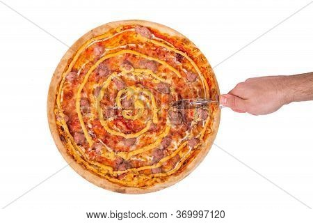 The Chef Cuts The Salsiccia Pizza With A Pizza Cutter, Top View. Tasty Pizza With Beef Sausages, Moz