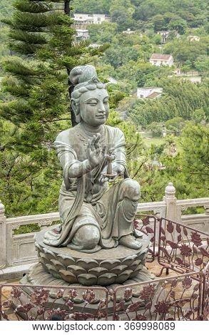 Buddhist Deva Statue Offering A Lamp To The Tian Tan Big Buddha  Statue On Lantau Island, Hong Kong