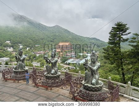 Gnong Ping, Lantau Island, Hong Kong, May 2018 - Buddhist Deva Statues Offering Gifts To The Tian Ta