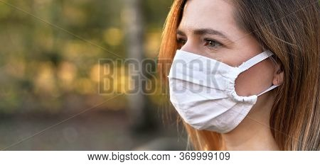 Young Woman Wearing White Home Made Cotton Virus Mouth Nose Mask, Nice Bokeh In Background, Closeup
