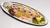 dish with fish on a plate lined with beautiful fruit poster