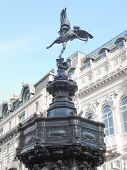 Piccadilly Circus with statue of Anteros aka Eros in London, UK poster