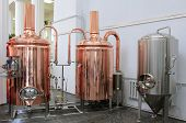 Copper tuns for brewing at a brewery poster