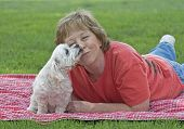 Adult Woman Getting A Kiss From Her Dog poster