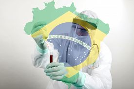Doctor Wearing Respiratory Mask And Holding The Coronavirus Covid-19 Blood Sample. Scientists Test F
